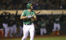 Oakland Athletics' Matt Olson watches his game winning home run hit off Houston Astros' Tony Sipp in the tenth inning of a baseball game Friday, Aug. 17, 2018, in Oakland, Calif. (AP Photo/Ben Margot)