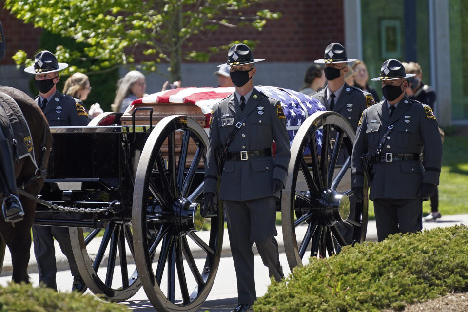 A caisson approaches the Holmes Convocational Center for the funeral services of Watauga County Sheriff's Deputies Sgt. Chris Ward and K-9 Deputy Logan Fox in Boone, N.C., Thursday, May 6, 2021. The two deputies were killed in the line of duty. (AP Photo/Gerry Broome)