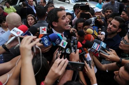 Venezuelan opposition leader Juan Guaido, who many nations have recognized as the country's rightful interim ruler, talks to the media while arriving  to attend a political rally in Caracas