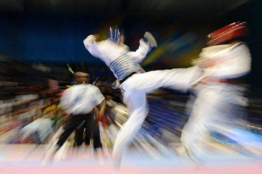 A taekwondo fighter who helped fund his Olympic dream by running a brothel has rejected being labelled a 'pimp'