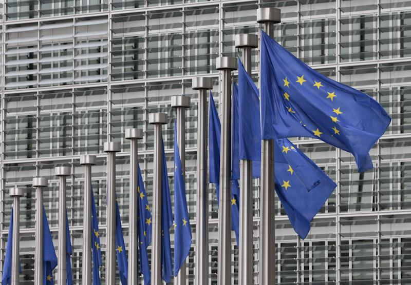 FILE - In this Monday, May 9, 2011 file photo, EU flags fly at the European Commission headquarters in Brussels. . The European Union has won the Nobel Peace Prize, it has been announced on Friday, Oct. 12, 2012. (AP Photo/Yves Logghe, File)