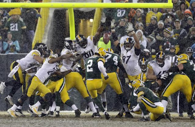 Green Bay Packers' Mason Crosby has a field goal attempt blocks during the second half of an NFL football game against the Pittsburgh Steelers Sunday, Dec. 22, 2013, in Green Bay, Wis. The Steelers were called for a batting penalty on the play. (AP Photo/Mike Roemer)