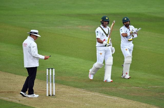 Pakistan's Mohammad Rizwan and Naseem Shah leave the pitch for bad light