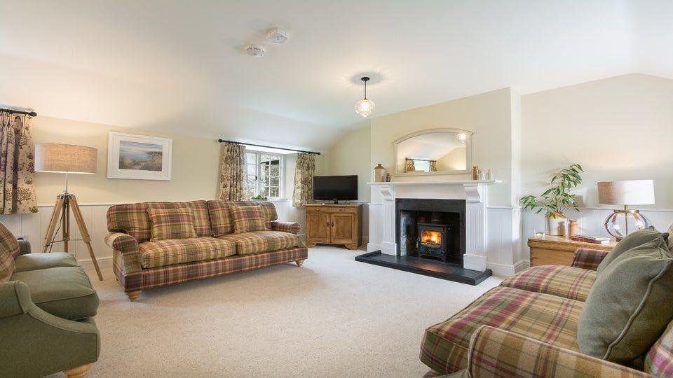 "<p>This traditional stone and slate Christmas cottage was once part of Triggabrowne, a traditional Cornish farming settlement. The first floor hosts the sitting room and kitchen, a clever twist allowing you to spend more time enjoying the wintry countryside views surrounding Fortescue. </p><p><strong>Be sure to... </strong>Discover the wide shingle beaches and turquoise waters at the coast between Polruan and Polperro. The National Trust looks after most of the nearby land, so while you're enjoying those bracing coastal walks, it's good to know you're also contributing to the upkeep of the footpaths you're walking along.</p><p><strong>Sleeps: </strong>6</p><p><strong>Pets:</strong> No</p><p><strong>Price:</strong> £1,099 for 7 nights over Christmas and New Year (short breaks can be booked one month before for peak periods)</p><p><a class=""link rapid-noclick-resp"" href=""https://go.redirectingat.com?id=127X1599956&url=https%3A%2F%2Fwww.nationaltrust.org.uk%2Fholidays%2Ffortescue-cornwall&sref=https%3A%2F%2Fwww.countryliving.com%2Fuk%2Ftravel-ideas%2Fstaycation-uk%2Fg33888029%2Fchristmas-cottage%2F"" rel=""nofollow noopener"" target=""_blank"" data-ylk=""slk:FIND OUT MORE"">FIND OUT MORE</a></p>"