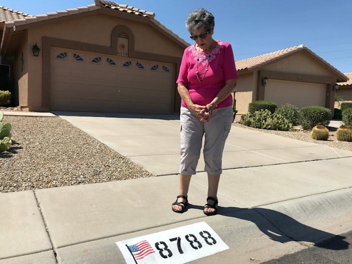 Donna Cordero, 82, of Peoria is fighting her homeowner's association's order to paint over the American flag displayed on her curb.