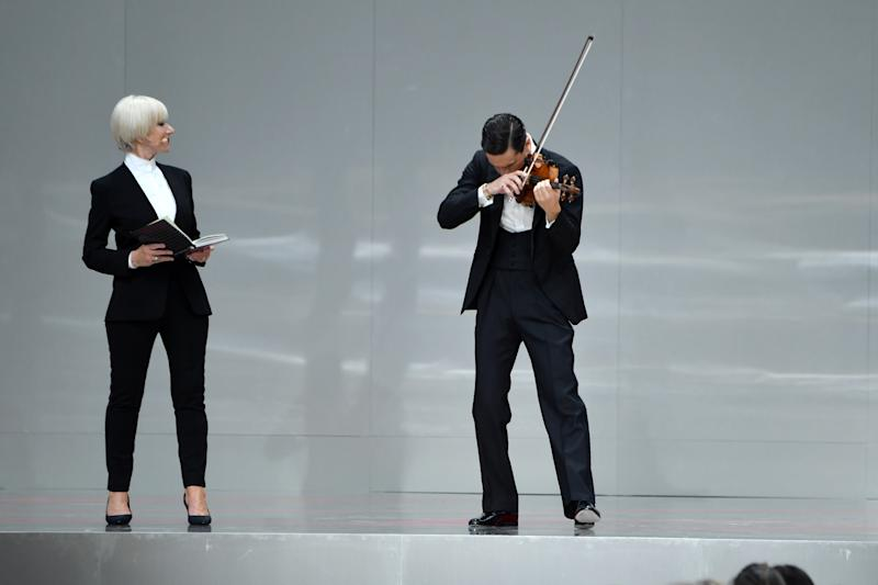 PARIS, FRANCE - JUNE 20: Helen Mirren and Charlie Siem are seen on stage during the Karl Lagerfeld Homage at Grand Palais on June 20, 2019 in Paris, France. (Photo by Pascal Le Segretain/Getty Images)