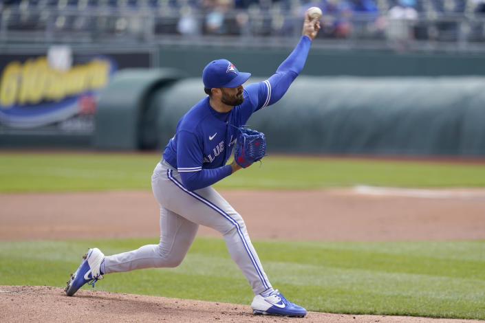 Toronto Blue Jays starting pitcher Robbie Ray delivers to a Kansas City Royals batter during the first inning of a baseball game at Kauffman Stadium in Kansas City, Mo., Sunday, April 18, 2021. (AP Photo/Orlin Wagner)