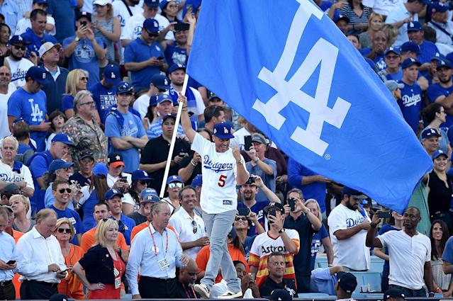 "<p>True-blue Dodgers fan Rob Lowe led the crowd in cheers and ran into legendary retired Dodgers announcer Vin Scully during his night at the ballpark.""If Heaven is real, it's probably something like this,"" he tweeted. (Photo: Kevork Djansezian/Getty Images) </p>"
