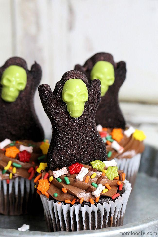 """<p>The reapers atop these cupcakes are actually made of Peeps and molded candy melts. How genius is that? </p><p><strong>Get the recipe at <a href=""""https://momfoodie.com/grim-reaper-halloween-cupcakes/"""" rel=""""nofollow noopener"""" target=""""_blank"""" data-ylk=""""slk:Mom Foodie"""" class=""""link rapid-noclick-resp"""">Mom Foodie</a>.</strong></p><p><strong><a class=""""link rapid-noclick-resp"""" href=""""https://www.amazon.com/Wilton-2115-3812-Skull-Candy-Mold/dp/B01I3ER9U8?tag=syn-yahoo-20&ascsubtag=%5Bartid%7C10050.g.1366%5Bsrc%7Cyahoo-us"""" rel=""""nofollow noopener"""" target=""""_blank"""" data-ylk=""""slk:SHOP SKULL CANDY MOLDS"""">SHOP SKULL CANDY MOLDS</a><br></strong></p>"""