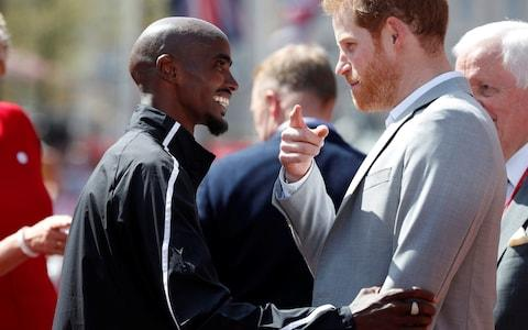 Prince Harry talks to Mo Farah - Credit: REUTERS
