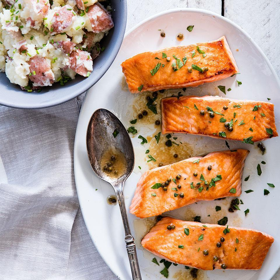 <p>A simple sauce of piquant green peppercorns, lemon juice and butter tops this seared salmon recipe. Green peppercorns come from the same plant as black ones, but are harvested before they mature. Typically packed in vinegar, they have a refreshingly sharp flavor. Look for them near the capers in most supermarkets. Serve with smashed red potatoes and sautéed kale.</p>