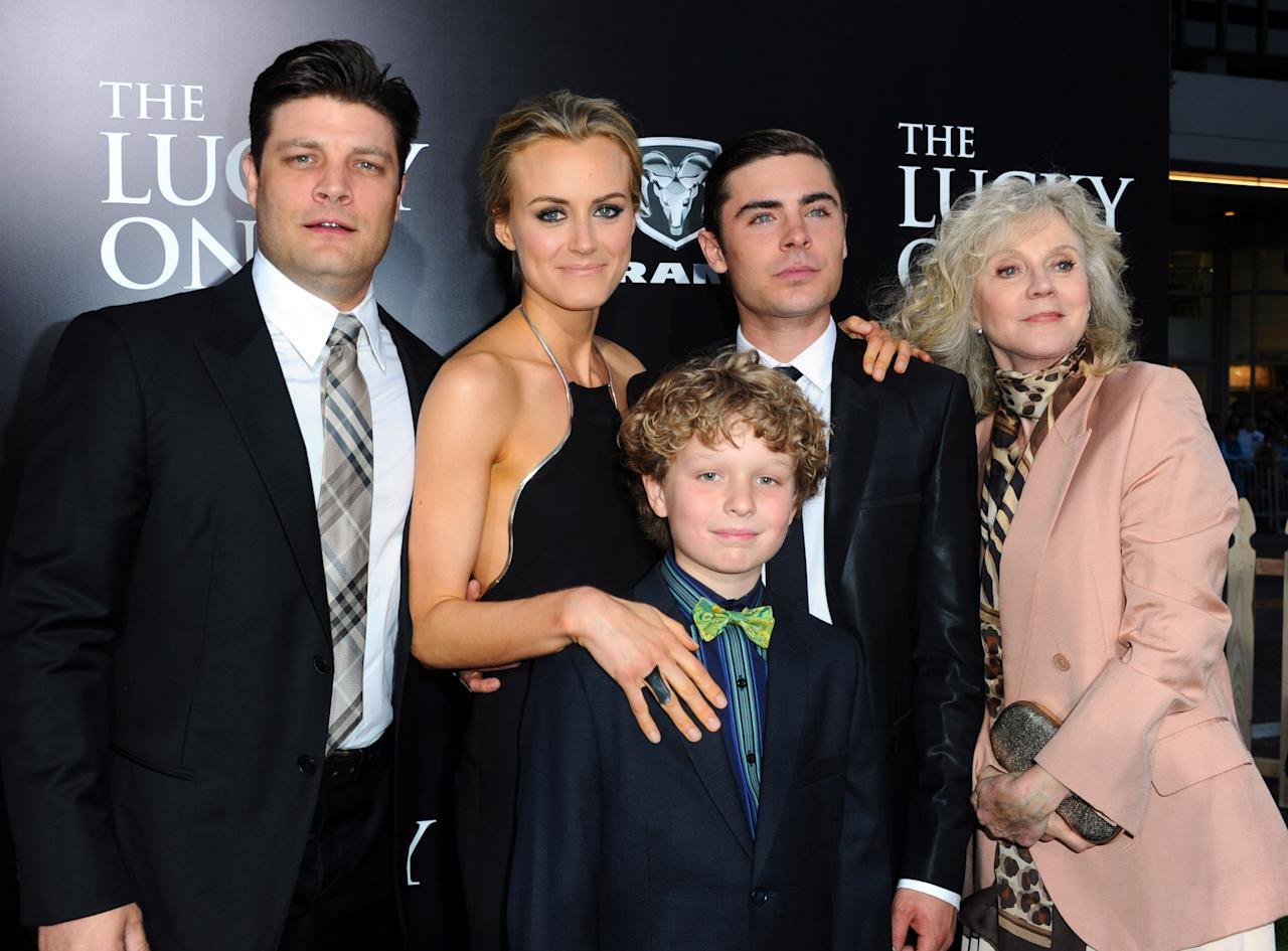 "HOLLYWOOD, CA - APRIL 16:  (L-R) Actors Jay R. Ferguson, Taylor Schilling, Riley Thomas Stewart, Zac Efron and Blythe Danner arrive at the premiere of Warner Bros. Pictures' ""The Lucky One"" at Grauman's Chinese Theatre on April 16, 2012 in Hollywood, California.  (Photo by Alberto E. Rodriguez/Getty Images)"