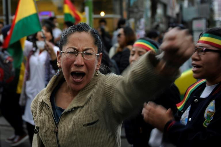 A woman shouts during a protest in La Paz against election results giving Evo Morales a fourth presidential term (AFP Photo/JORGE BERNAL)