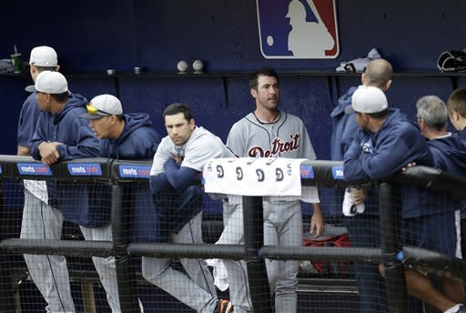 Detroit Tigers pitcher Justin Verlander, center right, stands in the dugout after completing a three-inning performance against the New York Mets during an exhibition spring training baseball game, Friday, March 1, 2013, in Port St. Lucie, Fla. (AP Photo/Julio Cortez)