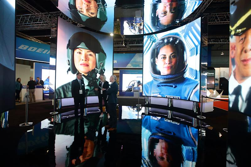 SINGAPORE - FEBRUARY 11: Visiotrs stand inside a video display at Boeing booth during the Singapore Airshow 2020 at the Changi Exhibition Centre on February 11, 2020 in Singapore. The Singapore Airshow is Asia's largest Aerospace and Defence event. (Photo by Suhaimi Abdullah/Getty Images)