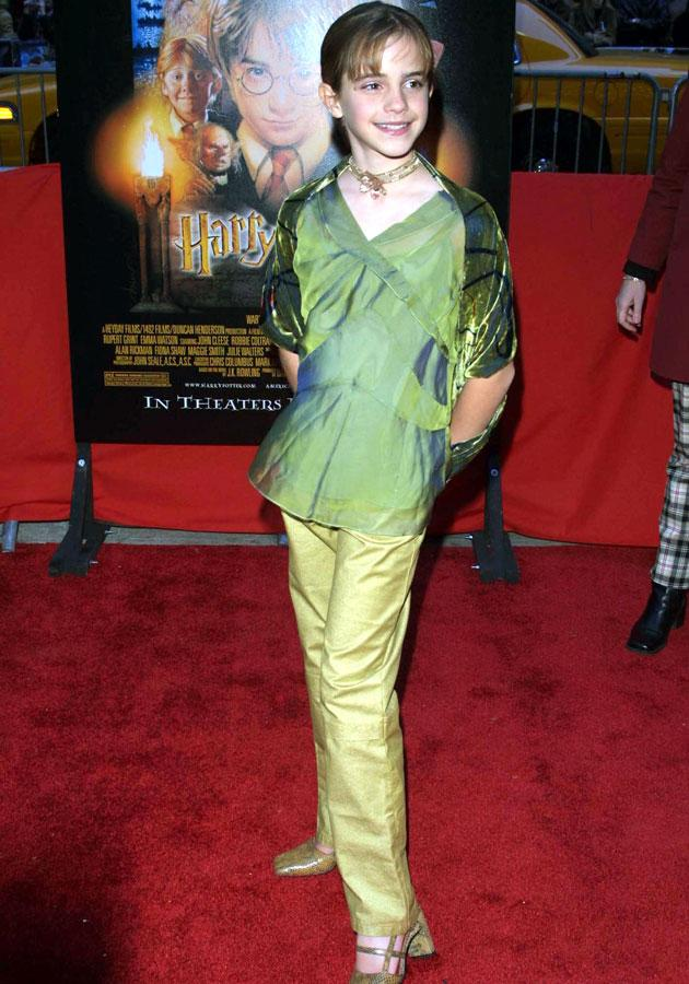 Emma Watson wore this green two-piece for her first red-carpet appearance at the Harry Potter and the Philosopher's Stone world premiere in New York.<br><br>All images [Rex]