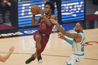 Cleveland Cavaliers' Collin Sexton (2) drives to the basket, and is fouled by Charlotte Hornets' P.J. Washington (25) during the first half of an NBA basketball game Wednesday, Dec. 23, 2020, in Cleveland. (AP Photo/Tony Dejak)
