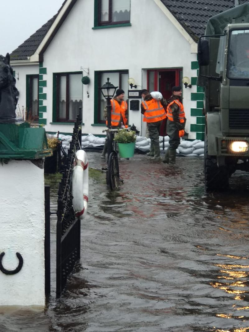 Members of the Defence Forces help with flood defences
