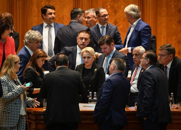 Dancila, centre, is seen with members of her cabinet after the no-confidence vote brought down the government