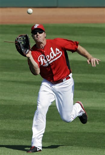 Cincinnati Reds right fielder Jay Bruce makes a running catch on a fly ball from Texas Rangers' Julio Borbon to end the top of the sixth inning of an exhibition spring training baseball game Saturday, March 23, 2013, in Goodyear, Ariz. (AP Photo/Mark Duncan)