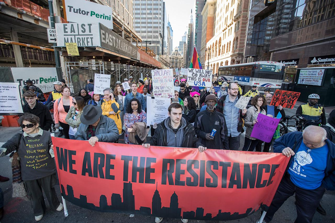 <p>People march during a protest Monday, Feb. 20, 2017, in Philadelphia. Thousands of demonstrators turned out Monday across the U.S. to challenge Donald Trump in a Presidents Day protest dubbed Not My President's Day. (Michael Bryant/The Philadelphia Inquirer via AP) </p>