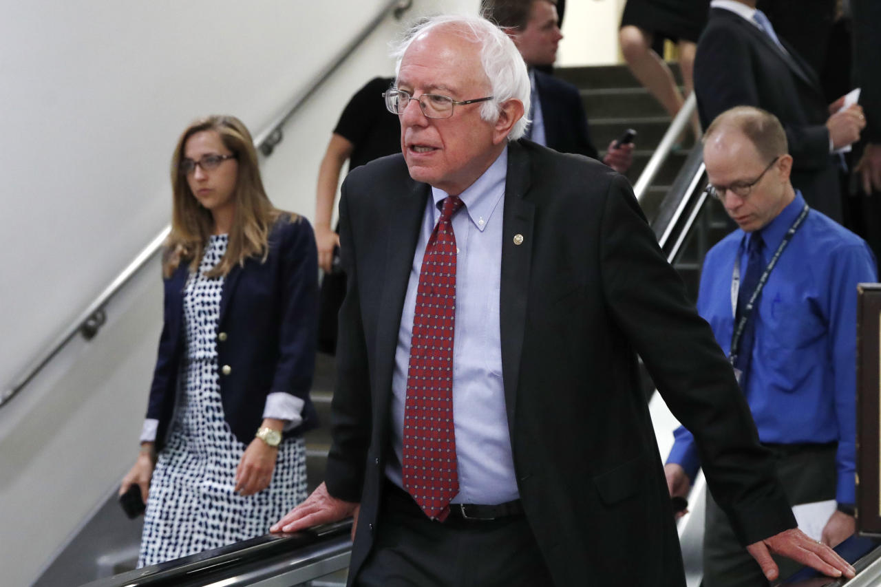 """FILE - In this July 11, 2017, file photo, Sen. Bernie Sanders, I-Vt., rides an escalator on Capitol Hill in Washington. Americans aren't too thrilled with """"Obamacare"""" and they definitely don't like the Republican plans offered in Congress, so what does the public want the government to do about health care? A new poll suggests the country may be shifting toward the political left, with 62 percent saying it's the federal government's responsibility to make sure that all Americans have health care coverage, while 37 percent say it is not. (AP Photo/Jacquelyn Martin, File)"""