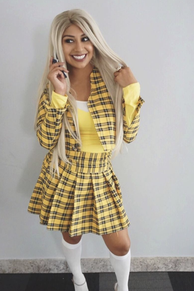 """<p>Think there's a better '90s costume out there? As if! If you're lucky, you can find the right plaid skirt suit, but it might be easier to simply buy a licensed costume. </p><p><em><a href=""""https://andiesparkles.com/yellow-plaid-skirt-diy-clueless-outfit/"""" rel=""""nofollow noopener"""" target=""""_blank"""" data-ylk=""""slk:Get the tutorial."""" class=""""link rapid-noclick-resp"""">Get the tutorial.</a></em></p><p><a class=""""link rapid-noclick-resp"""" href=""""https://www.amazon.com/Clueless-Costume-Officially-Licensed-X-Small/dp/B01M0576DJ?tag=syn-yahoo-20&ascsubtag=%5Bartid%7C10072.g.37059504%5Bsrc%7Cyahoo-us"""" rel=""""nofollow noopener"""" target=""""_blank"""" data-ylk=""""slk:SHOP SKIRT"""">SHOP SKIRT</a></p>"""
