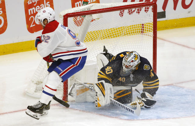 Buffalo Sabres goalie Carter Hutton (40) stops Montreal Canadiens forward Jonathan Drouin (92) during the first period of an NHL hockey game Wednesday, Oct. 9, 2019, in Buffalo, N.Y. (AP Photo/Jeffrey T. Barnes)