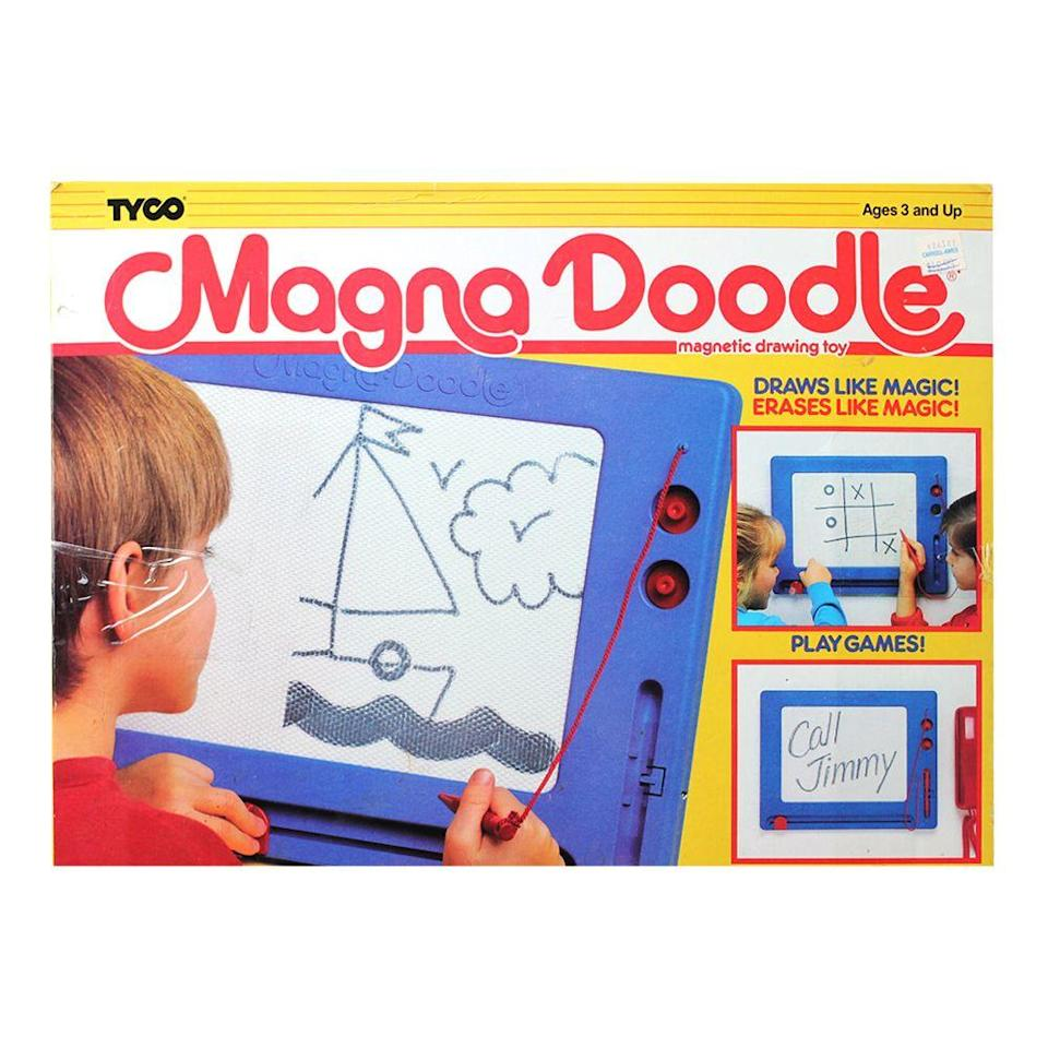 "<p><a class=""link rapid-noclick-resp"" href=""https://www.amazon.com/Cra-Z-Art-14526-Original-Magna-Doodle/dp/B005NJT4S2/ref=sr_1_7?tag=syn-yahoo-20&ascsubtag=%5Bartid%7C10063.g.34738490%5Bsrc%7Cyahoo-us"" rel=""nofollow noopener"" target=""_blank"" data-ylk=""slk:BUY NOW"">BUY NOW</a><br></p><p>Magna Doodle was the dustless chalkboard that made it fun to doodle mess-free. The mechanism was similar to the Etch A Sketch. The magnetic particles would be lifted to the surface wherever you placed the plastic pen.</p>"