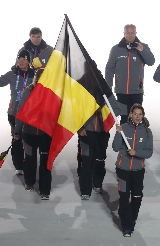 Belgium's flag-bearer Hanna Emilie Marien leads her country's contingent during the opening ceremony of the 2014 Sochi Winter Olympics, February 7, 2014. REUTERS/Lucy Nicholson (RUSSIA - Tags: OLYMPICS SPORT)