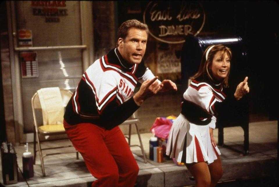 """<p><strong>For both:</strong> A red and black cheerleading outfit with a white sash that says """"Spartans.""""</p>"""