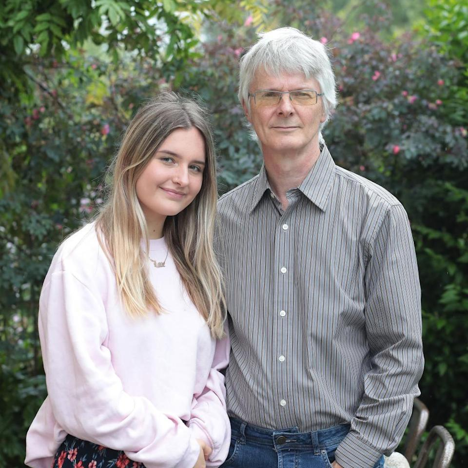 Michael Bell with daughter, Lexie who fears that the predicted As she is expecting will be marked down due to her school's previous lower results in her subjects.