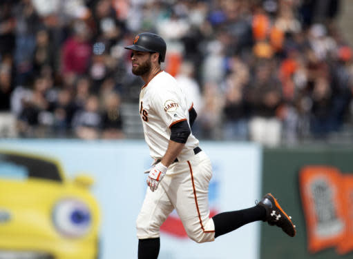 San Francisco Giants' Brandon Belt runs out his three-run home run against the Colorado Rockies during the seventh inning of a baseball game, Sunday, May 20, 2018, in San Francisco. (AP Photo/D. Ross Cameron)
