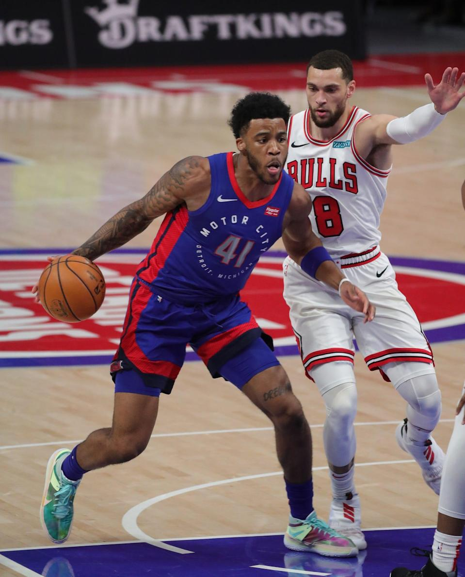 Pistons forward Saddiq Bey drives against Bulls guard Zach LaVine during first quarter Sunday, March 21, 2021 at Little Caesars Arena.