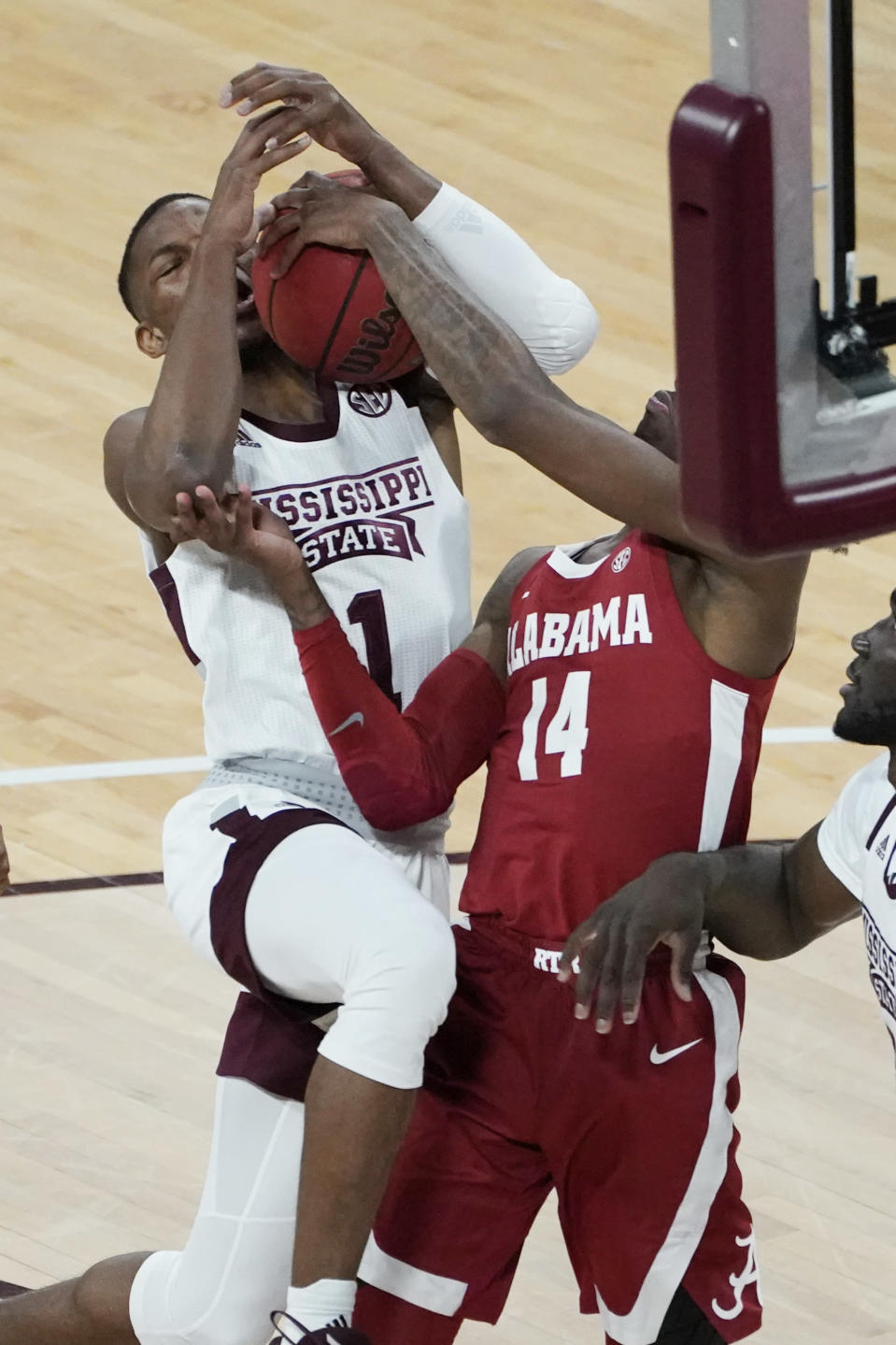 Mississippi State guard Iverson Molinar (1) has the ball stripped away by Alabama guard Keon Ellis (14) during the first half of an NCAA college basketball game in Starkville, Miss., Saturday, Feb. 27, 2021. (AP Photo/Rogelio V. Solis)
