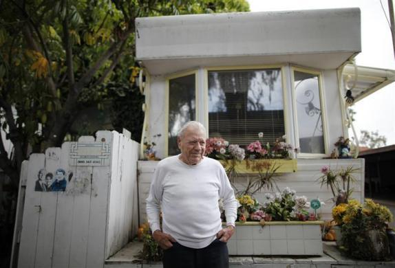 Vernon Van Wie, 91, who is partially blind, stands outside his trailer in which he has lived for 20 years, in Village Trailer Park in Santa Monica, July 13, 2012.