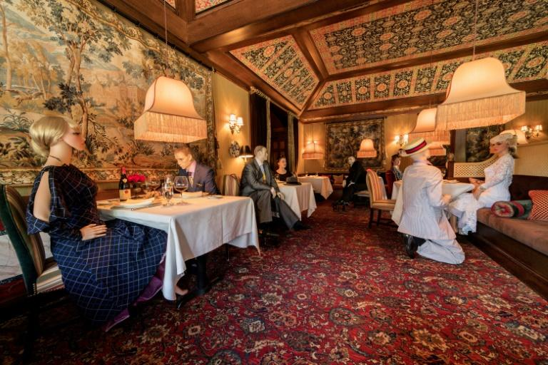 The Inn at Little Washington has collaborated with local businesses on staging, costumes and make-up for the mannequins, strategically placed at tables which must remain empty (AFP Photo/-)