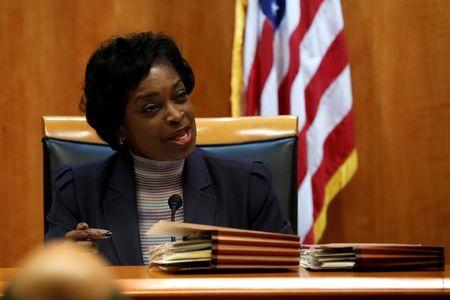 Commissioner Mignon Clyburn speaks ahead of the vote on the repeal of so called net neutrality rules at the Federal Communications Commission in Washington