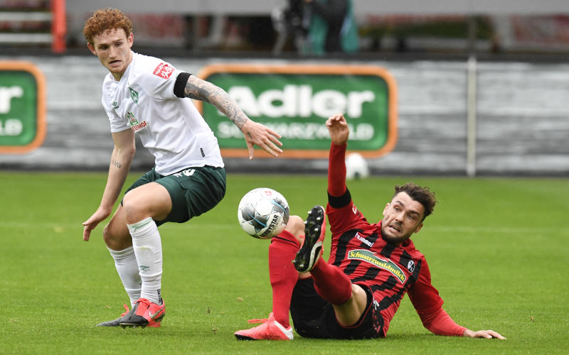 In his first start since the Bundesliga's return, American striker Josh Sargent (left) helped relegation-threatened Werder Bremen secure a crucial win. (Thomas Kienzle/Getty Images)