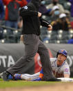 New York Mets' Jeff McNeil, right, reacts as he is called out by third base umpire Nic Lentz after McNeil tried to stretch a double into a triple in the ninth inning of a baseball game against the Colorado Rockies, Sunday, April 18, 2021, in Denver. (AP Photo/David Zalubowski)