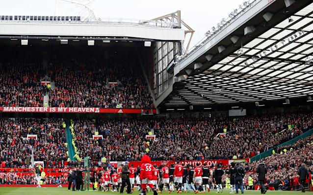 """Manchester United have taken the first steps towards trying to improve Old Trafford's flagging atmosphere by introducing a heavily discounted season ticket for 18-25 year olds seated in the lower Stretford End. Fans in that age category sat in what is traditionally regarded as the loudest section of the ground will pay £285 for a season ticket, almost half the cost of the cheapest adult season ticket. United have also chosen to freeze season ticket prices for the seventh straight year. The move follows a meeting between senior club officials and the Manchester United Supporters' Trust (MUST) over ways to improve the matchday atmosphere as well as criticism from manager Jose Mourinho, who has been unhappy with the noise levels inside Old Trafford since taking charge almost two years ago. Mourinho has criticised the atmosphere on several occasions, most recently after the 2-0 Premier League win over Huddersfield Town last month when he complained about the stadium being """"quiet"""" and claimed the atmosphere at Portsmouth's Fratton Park was far better. Ed Woodward, the United executive vice-chairman, met with Mourinho over the matter and the club's hierarchy are thought to share his concerns and are committed to addressing the situation. MUST, who had proposed cheaper season tickets in the 18-25 bracket during talks with the club in a bid to boost the atmosphere and entice younger, louder supporters who have been priced out, have welcomed the measure. Jose Mourinho has criticised the Old Trafford atmosphere Credit: REUTERS In a statement, MUST said: """"We welcome the precedent of a new 18-25 ticket price. While this is only available in a small area for now, it starts to demonstrate an understanding that groups of young adults have felt priced out in the past, particularly at the transition point from youth to full adult pricing."""" MUST have also made a series of other proposals, including the relocation of executive fans, part of the family stand and the disabled section, i"""