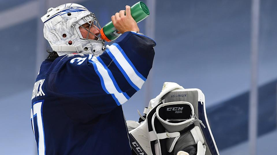 Connor Hellebuyck has put the Winnipeg Jets on his back. (Photo by Andy Devlin/NHLI via Getty Images)