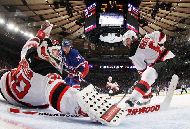 NEW YORK, NY - MAY 14:  Martin Brodeur #30 and Andy Greene #6 of the New Jersey Devils defend against the New York Rangers in Game One of the Eastern Conference Finals during the 2012 NHL Stanley Cup Playoffs at Madison Square Garden on May 14, 2012 in New York City.  (Photo by Bruce Bennett/Getty Images)