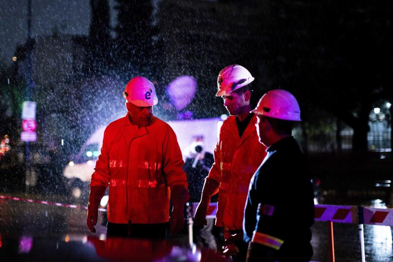 """Technicians of Edenor electricity company stand under the rain as they work to fix a generator during a blackout in Buenos Aires, Argentina, Sunday, June 16, 2019. A massive blackout left tens of millions of people without electricity in Argentina, Uruguay and Paraguay on Sunday in what the Argentine president called an """"unprecedented"""" failure in the countries' power grid. (AP Photo/Tomas F. Cuesta)"""