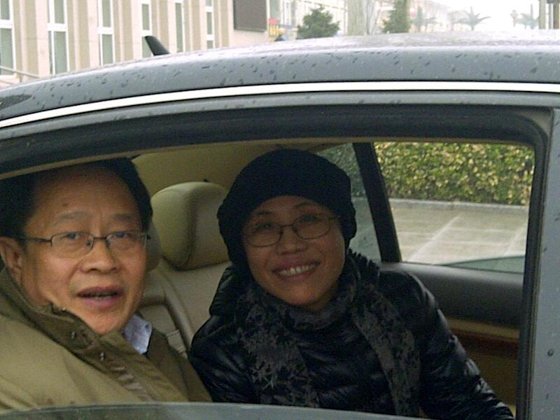 Liu Xia, wife of jailed Nobel Peace Prize winner Liu Xiabao, right, sits inside a car after attending her brother court case in a court on the outskirt of Beijing Tuesday, April 23, 2013. The brother-in-law of China's jailed Nobel Peace Prize winner Liu Xiabao has gone on trial on fraud charges that his lawyers say amount to a trumped-up case aimed at punishing the family. (AP Photo)