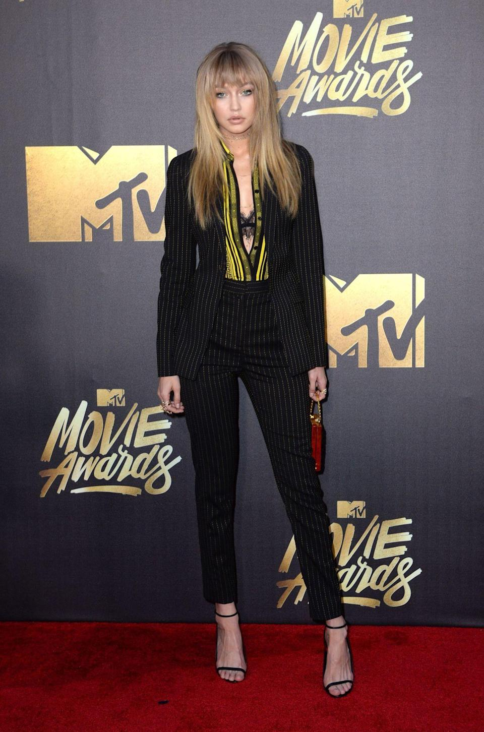 <p>Gigi's modelled for Versace, Tommy Hilfiger and Maybelline in the past year helping her become one of the world's top models. <i>[Photo: PA]</i></p>