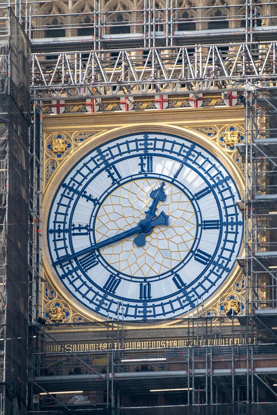 The St George's cross shields above the Big Ben clock face have been painted red and white (PA)