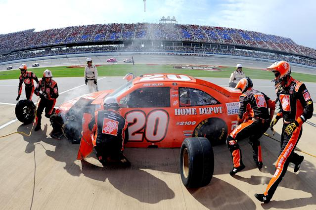 TALLADEGA, AL - OCTOBER 23: Joey Logano, driver of the #20 The Home Depot Toyota, makes a pit stop during the NASCAR Sprint Cup Series Good Sam Club 500 at Talladega Superspeedway on October 23, 2011 in Talladega, Alabama. (Photo by Jason Smith/Getty Images)