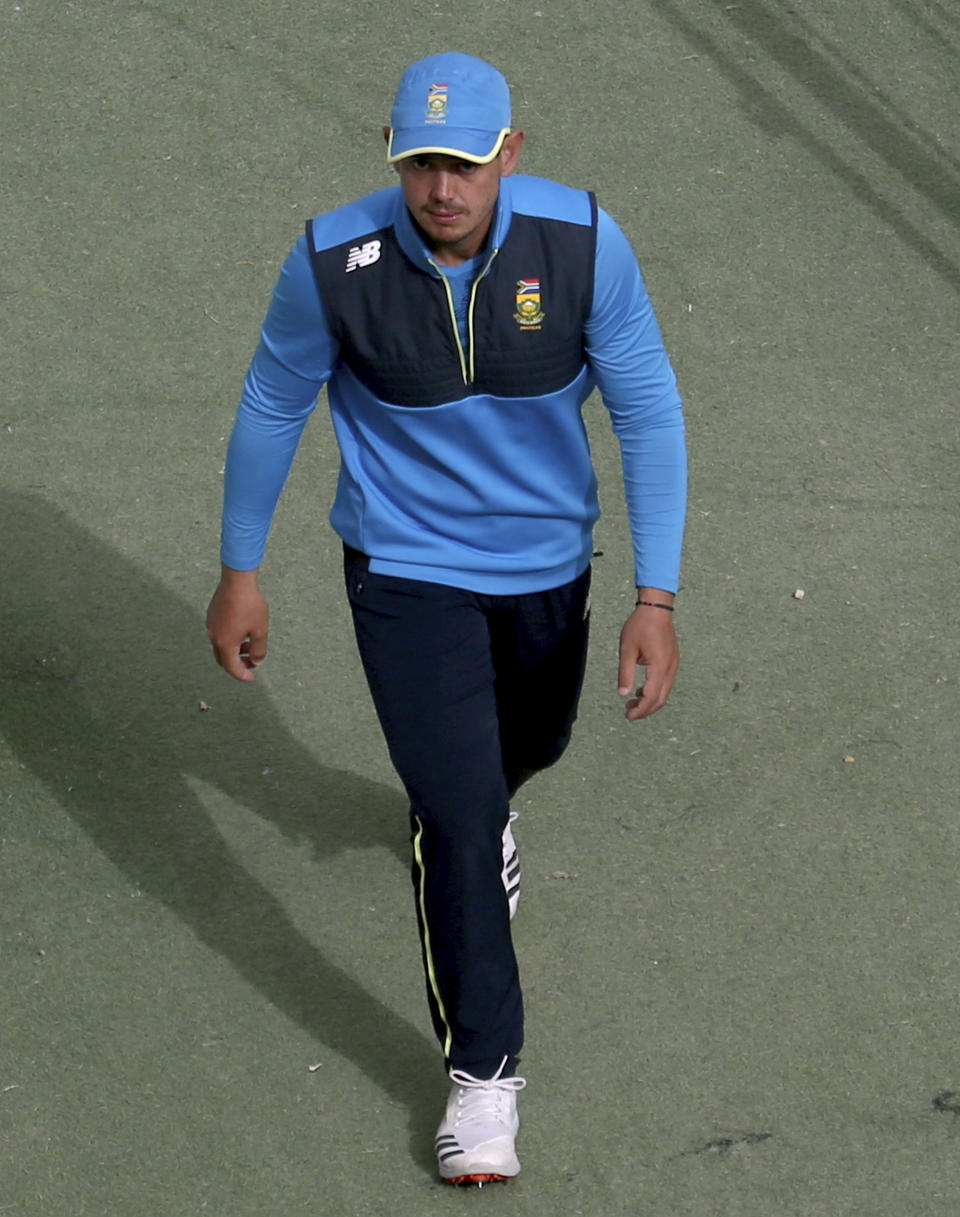 South Africa cricket team's skipper Quinton de Kock walks back from the field after attending a practice session at the National Cricket Stadium, in Karachi, Pakistan, Saturday, Jan. 23, 2021. South Africa, which arrived in the southern port city of Karachi for the first time in nearly 14 years, will play the first test match against Pakistan starting on Jan. 26. (AP Photo/Fareed Khan)