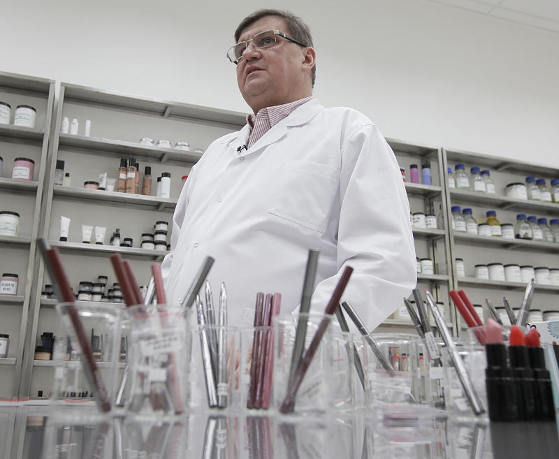 In this Feb. 14, 2013 photo, Wojciech Inglot, founder and president of the Polish cosmetics company Inglot, gestures as he stands in a room containing ingredients for his cosmetics in Przemysl, Poland. Inglot and some Muslims say the company's O2M breathable nail polish is the first of its kind because it lets air and moisture pass through to the nail. A craze has built up around it with Muslim women in recent months after an Islamic scholar in the United States tested its permeability and published an article saying that, in his view, it complies with Muslim law.   (AP Photo/Czarek Sokolowski)
